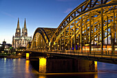 Cologne Cathedral and Hohenzollern Bridge at night, Cologne, North Rhine-Westphalia, Germany