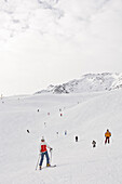Female Ski driver is being fotographed on a ski piste, Schnalstal, south Tyrol, Italy