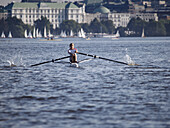 Boy rowing on the Lake Alster, Hamburg, Germany