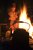Sami (lapp) people. Sami experience in Boazo Sámi Siida. Coffe and fire inside a tent.  Alta. Finnmark. Lapland. Norway.