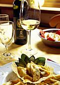 La Rocca da Paolo' restaurant. Tortellini di Ricotta e Spinaci al Burro Fuso e Salvia con Cialda di Formaggio Grana and Ortrugo wine. Castell'Arquato. Emilia Romagna. Val d'Arda. Italy.