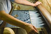 Croix Rousse: Maison des Canuts, working to an ancient loom, Lyon. Rhône-Alpes, France
