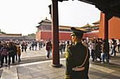 Forbidden City. A guard near the Meridian Gate. Beijing city. China.