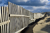 Beach, Beaches, Coast, Coastal, Color, Colour, Daytime, Deserted, Exterior, Fence, Fences, Nature, Nobody, Obstacle, Obstacles, Outdoor, Outdoors, Outside, Sand, Scenic, Scenics, Seascape, Seascapes, Wood, Wooden, A75-666861, agefotostock