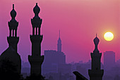 Minarets of Hassan mosque at sunset, view from citadel .City of Cairo. Egypt.