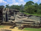 Giant Buddha. Kalu Gal Vihara. Polonnaruwa, Sri Lanka medieval capital (established as the first city of the land in the 11th century), Sri Lanka