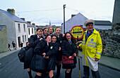 School crossing guard, lollipop man, with school children, Bogside, Derry, Co. Londonderry, Northern Ireland, Great Britain, Europe