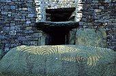 An ornated stone at a gravesite, Newrange, County Meath, Ireland, Europe