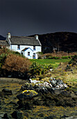Cottage at Coulagh Bay under rain clouds, County Kerry, Ireland, Europe