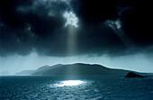 Sunbeams shining through dark cloud cover at Dingle Bay, Great Blasket Island, County Kerry, Ireland, Europe