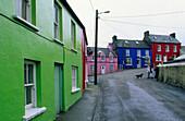 Colourful houses under clouded sky, Eyeries, Beara peninsula, County Cork, Ireland, Europe