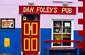 View at the colourful facade of Dan Foley's Pub, Anascaul, County Kerry, Ireland, Europe