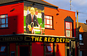 View at the colourfully painted facade of The Red Devil Pub, Belfast, County Antrim, Ireland, Europe