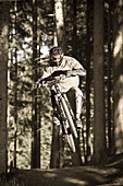 A teenager on his mountain bike during a jump, Downhill Park, Wagrain, Austria