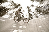 A teenager driving a ground loop with his mountain bike, Downhill Park, Wagrain, Austria