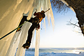 Man ice climbing, Abashiri, Hokkaido, Japan