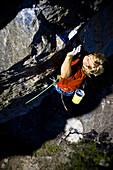 A man climbing up a rock face, Oetztal, Tyrol, Austria