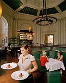 Waitress serving dessert at Logan Brown Restaurant, Cuba Street, Wellington, North Island, New Zealand