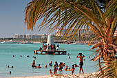 Aruba, Palm Beach, West Indies, Dutch Carribean, Central America, local people at the beach on sunday