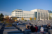 Berlin Holocaust Memorial, Beton stelen by architect Peter Eisenmann, background new American Embassy