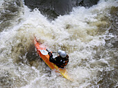 Kayak in the white water of the Regnitz River, Franconia, Bavaria, Germany