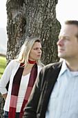 Mid adult couple near a tree