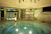 Woman in the Mineral spa pool of the Roman Irish Bath in Scuol, Lower Engadine, Engadine, Switzerland
