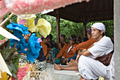 Gamelan musician at a cremation ceremony in Amed, Bali, Indonesia