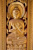 Golden buddhistic ornament at the door of the temple Ho Phra Bang, Luang Prabang, Laos