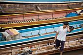 Fisherman in front of narrow boats, Luang Prabang province, Laos