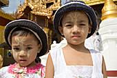 Two burmese girls in front of the Shwedagon Pagoda at Yangon, Rangoon, Myanmar, Burma
