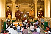 Buddha statues inside the Shwedagon Pagoda at Yangon, Rangoon, Myanmar, Burma