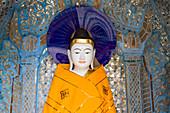 Head of a Buddha statue on the grounds of the Shwedagon Pagoda at Yangon, Rangoon, Myanmar, Burma