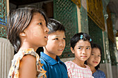Four burmese children on the grounds of the Shwedagon Pagoda at Yangon, Rangoon, Myanmar, Burma