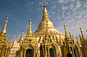 The golden main stupa of the Shwedagon Pagoda surrounded by small stupas at Yangon, Rangoon, Myanmar, Burma