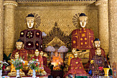 Buddha statues in golden prayer hall on the grounds of the Shwedagon Pagoda at Yangon, Rangoon, Myanmar, Burma