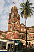 Palm tree in front of colonial central post office at Yangon, Rangoon, Myanmar, Burma
