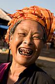 Portrait of a laughing burmese woman with headscarf, Yangon, Myanmar, Burma