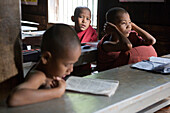 Buddhistic pupils at Pali-School in Bagaya Monastery on Inwa island ( Ava ) at Ayeyarwady River near Amarapura, Myanmar, Burma