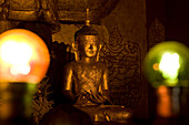 Golden buddhistic figure in Bagan, Myanmar, Burma