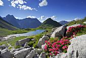 Lake Seewisee with alpine lodge Memminger hut and Seekogel, Lechtal range, Tyrol, Austria