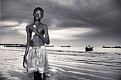 Young fishermen in the evening. Gambia