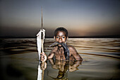 Boy fishing in Lake Awasa at sunset. South Ethiopia. African People