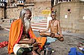 Meditation on the Ganges ghats, Varanasi. Uttar Pradesh, India