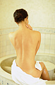 Adult, Adults, Back, Back view, Backs, Bare, Bath, Bathing, Bathroom, Bathrooms, Baths, Beauty, Beauty Care, Body, Body care, Brunette, Brunettes, Caucasian, Caucasians, Color, Colour, Contemporary, Dark-haired, Female, Gesture, Gestures, Gesturing, Groom