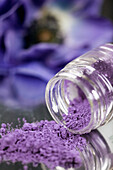 Close up, Close-up, Closeup, Color, Colour, Concept, Concepts, Flower, Flowers, Glass, Indoor, Indoors, Interior, Jar, Jars, Mirror image, Mirror images, Object, Objects, Open, Pigment, Pigments, Powder, Purple, Reflection, Reflections, Selective focus, S