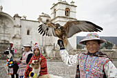 Woman with eagle, Yanque, Colca Canyon, Peru