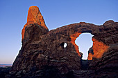 First light on Turret Arch, Windows Section Arches National Park, Utah, USA
