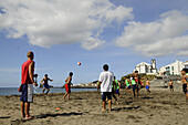 Teenagers playing football on the beach of Sao Roque, near Ponta Delgada, Sao Miguel, Azores, Portugal