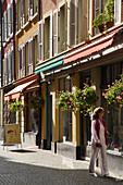 Woman window shopping along Rue du Lac, Vevey, Canton of Vaud, Switzerland